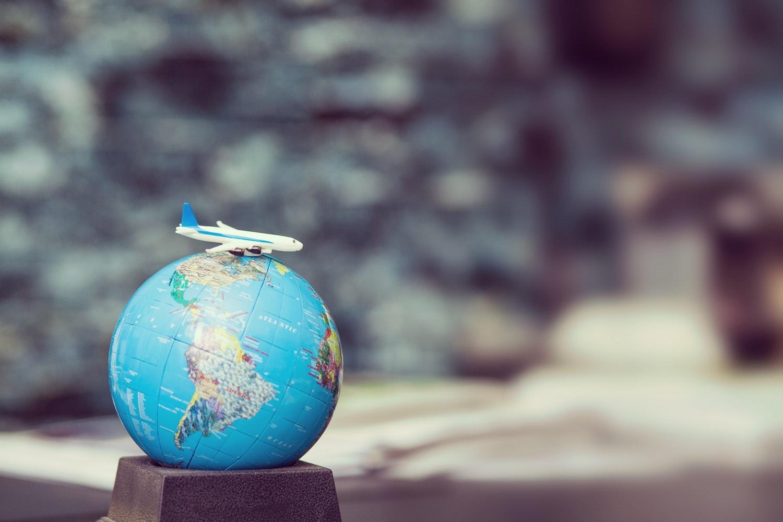toy plane on globe